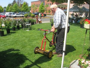 crazy inventors like this guy who took an old bicycle and made it into a foot propelled lawn mower!