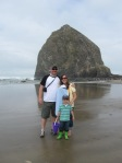 Standing in front of Haystack Rock in Cannon Beach
