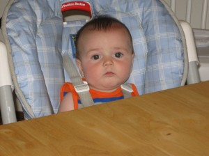 Chase is so little and yet so big! He's sitting in the high chair and eating cereal 3 times a day!