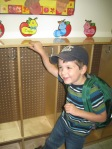 Standing Next to His Cubby at School